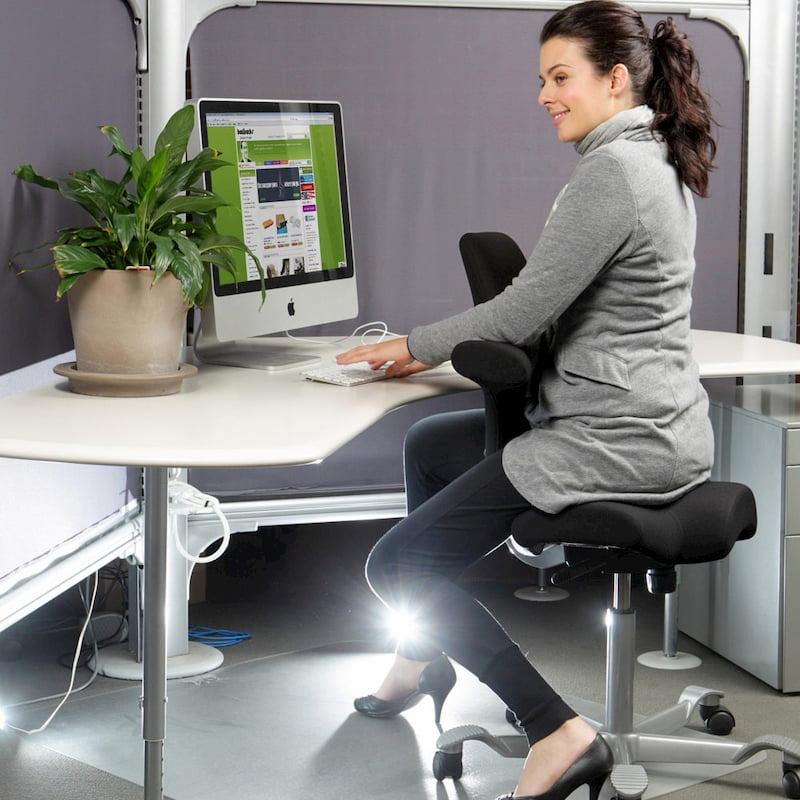 girl sitting on hag capisco office chair