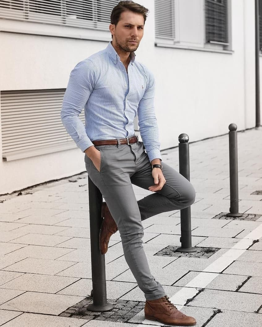man on the street wearing corporate shirt and pants with brown belt and shoes