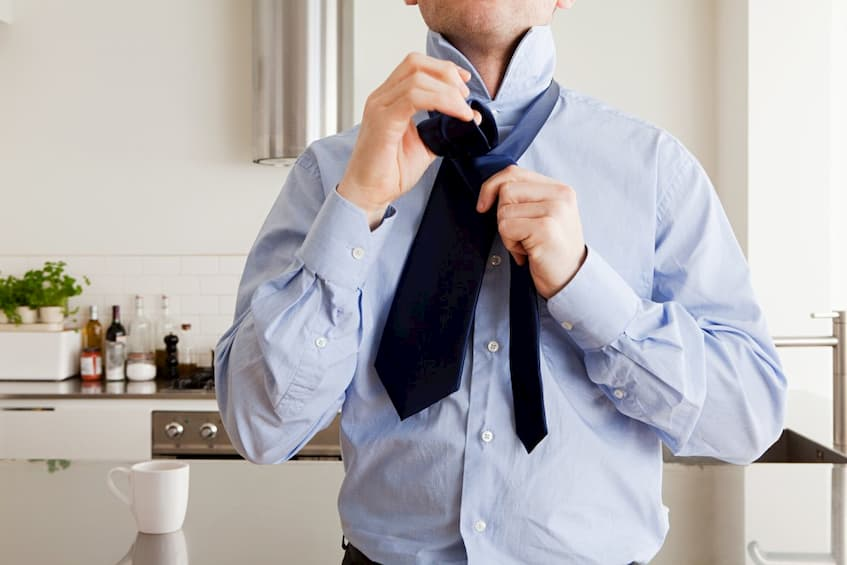 man wearing corporate shirt and a tie