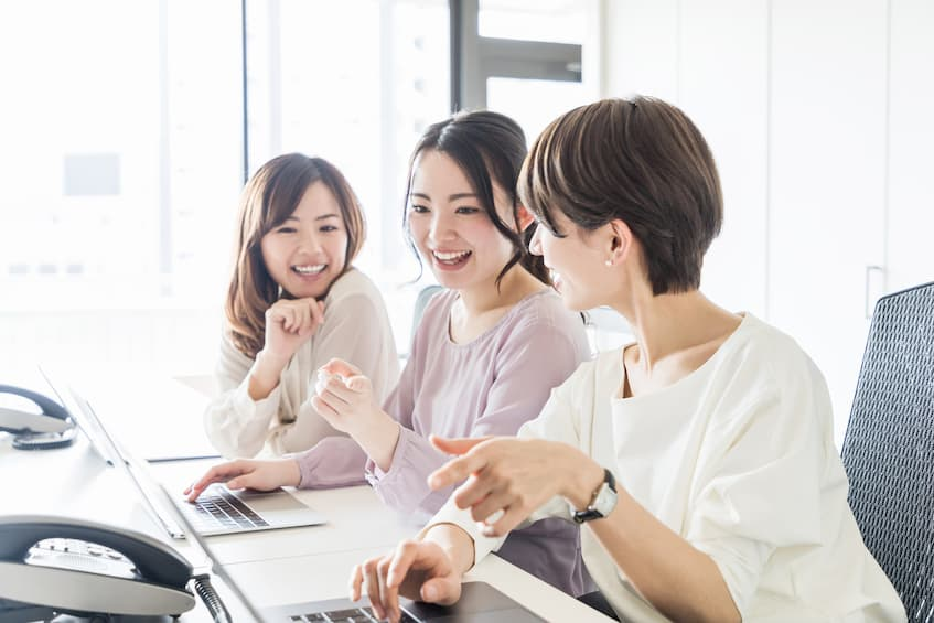 three women working at the office